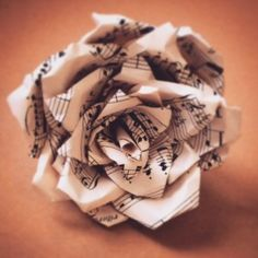 Beautiful hand crafted paper rose - recycled from old music sheets www.madebykatyjane.com #rose #music #musicpaper #papercraft #weddings #decorations #flowers