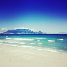 an amazing beach whee you can see table mountain from. windy on most days. Table Mountain, Tourist Places, Beach Fun, Cape Town, South Africa, Day, Amazing, Water, Outdoor