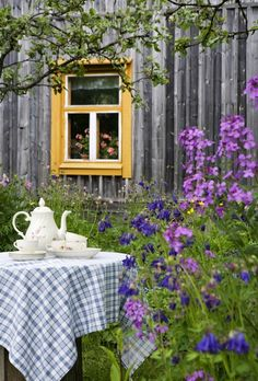 place for table and tea does not need to be arranged, maybe just a bit of lawn in a sea of flowers?