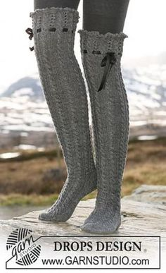 "Ravelry: Long socks in ""Fabel"" with cables, lace pattern and silk ribbon pattern by DROPS design. Drops Design, Mode Crochet, Thigh High Socks, High Knees, Crochet Slippers, Knitting Socks, Free Knitting, Loom Knitting, Crochet Clothes"
