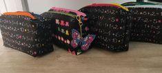 Trousses Zip-Zip noires à motifs colorés cousues par Maryline - Patron Sacôtin