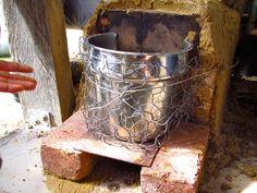 Rocket Stove Water Heater Redux - The Permaculture Research Institute Rocket Stove Water Heater, Rocket Stoves, Permaculture Courses, Steel Bucket, Natural Homes, Chicken Coop Plans, Wood Source, Heat Exchanger, Survival