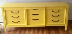 Old dresser turned into a wonderful accent/tv stand!!! Dresser $70.00, Yellow Paint $38.00,  I had some left over Black spray paint for the door hinges and drawer pulls. Total $108.00