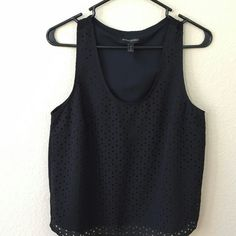 Little Triangles Cutout Tee Pour Petite Cute little triangles are designed to perfection to catch everyone's eye. Never worn, extremely new.  ~Sleeveless Petite Tee. ~Made in Indonesia. Banana Republic Tops Tank Tops