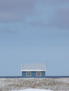 Blue beach hut in the winter. Perfect solitude.