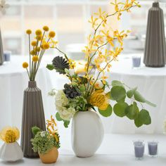 love this with the origami flowers added in and vases are awesome