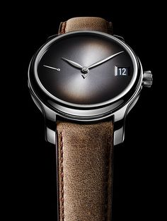 "The H. Moser & Cie Endeavour Perpetual Calendar Concept features the brand's hallmark, smoke-gray ""fume"" dial with sunburst pattern; the hours and minutes are indicated by leaf-shaped hands, while an arrow-tipped hand points to the month. Read more at: http://www.watchtime.com/wristwatch-industry-news/watches/sihh-2016-preview-h-moser-cie-endeavour-perpetual-calendar-concept/ #watchtime #horology #watchnerd #menswatches #SIHH2016"