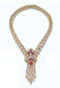 A ruby and diamond necklace designed as three rows of marquise-shaped gold links with brilliant-cut diamonds suspending a brilliant-cut diamond openwork pendant with pear-shaped ruby detail and gold-link tassel
