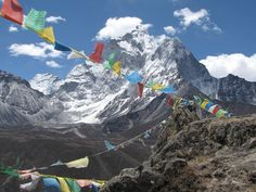 visit base camp at Mount Everest..send a prayer flag to the top of the world