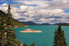 Little island in Abraham Lake at the David Thompson Highway. Nice spot to stop just befre entering Banff National Park from the east.- from Jens Gaethje Behance profile.