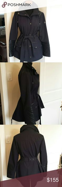 Michael Kors Waterproof Belted Winter Coat Gorgeous navy blue belted winter coat from Michael Kors. Hidden hood in collar, zips, buttons and ties. Leather cuffs and shoulders. Worn a handful of times, very slight signs of wear. Condition is as shown. Lined with a soft furry lining and outer shell is waterproof. Silver hardware. Feel free to make an offer! :) Michael Kors Jackets & Coats