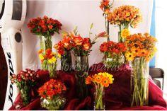 Decoración floral tonos naranjos, Diseño Flores y Piedras. www.floresypiedras.cl