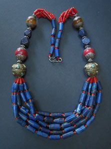 ☮ American Hippie Bohemian Style ~ Boho Jewelry .. This necklace originates from Nepal with 5 strands of lapis beads with tiny coral and brass spacers at centre. 2 brass Nepalese beads with turquoise inlay, 2 Sherpa coral and 2 resin amber repousse silver beads and if finished with a metal s-hook.