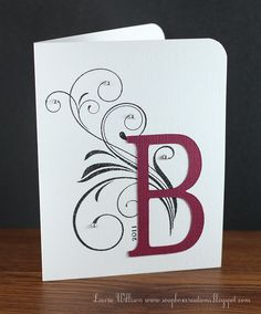 handmade monogram card ... clean and simple ... stamped flourish with a large die cut letter on top ... perfect for a quick notecard ...