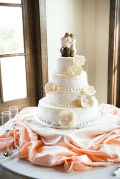 Wedding Cake (Publix)  Magnolia & peach satin accents, cake topper presented as Engagement gift by Mother of Bride (Willow Tree)