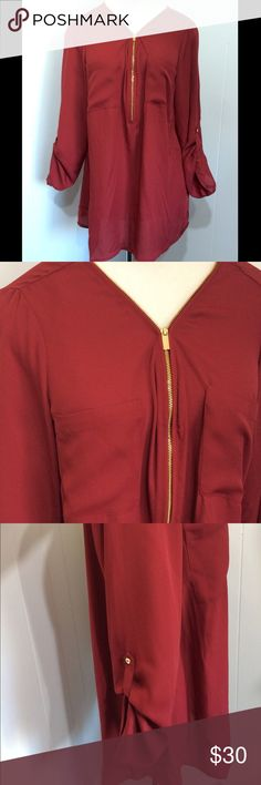 Sexy Red Tunic 1X XL Gold Zipper New with rage. Marked 1x but fits XL better imo. Red with gold Zipper  and buttons on sleeves. Double front pockets. zac & rachel Tops Blouses