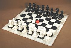 """It'll be love at first checkmate this Christmas with our classy and classic black and white Alabaster chess set! 14.5"""" x 14.5"""" x 0.5"""" board, 1.5"""" squares, 3"""" king with 1.13"""" king base width. #alabasterchesssets #chesssetgifts"""