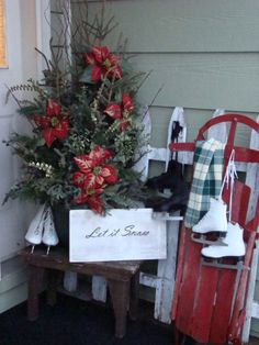 white picket fence & red sled porch for winter