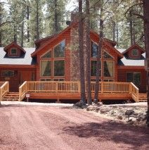 This style A frame windows, center fireplace, long deck with two stair cases.