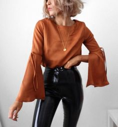 Trending Now: Statement Sleeves | Exploring Life's Beauty | Vinyl Leather Pants bell outfit short hair