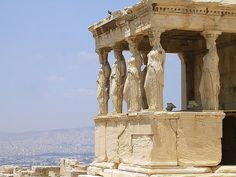 Photo of the caryatids of the Erechtheion on the Acropolis in Athens by @Trent Strohm