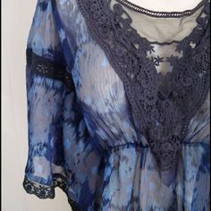 Free People peasant top Semi sheer blue and black boho watercolor peasant top from Free People. Pretty lace trim in front and at sleeves. Elastic front leaves plenty of room for this to fit many sizes. Pre worn condition with little signs of wear. No holes in lace or fabric. Very beautiful! Free People Tops