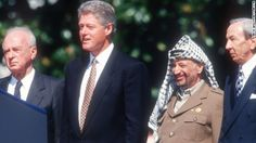 Israeli Prime Minister Yitzhak Rabin, U.S. President Bill Clinton, Palestinian leader Yasser Arafat and U.S. Secretary of State Warren Christopher
