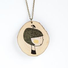 Girl with bird  illustrated wooden necklace by depeapa on Etsy, $25.00