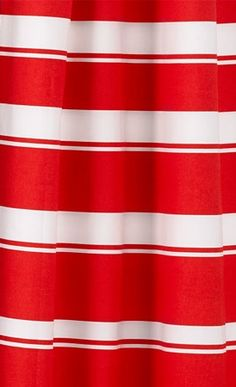 Graduated banding gives this shower curtain with a classic stripe a shake-up in eye-catching coral. About $30; Crate & Barrel