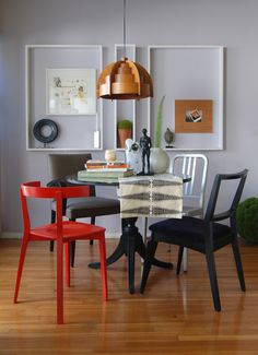 Dark floors with grey walls dining room eclectic with pendant light picture frames