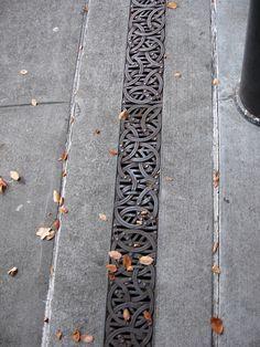 Celtic knotwork drain in Seattle, photo by Fran Fuller-Watson.