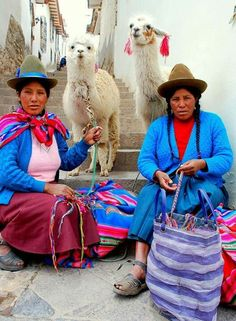 Andean women with their llama friends