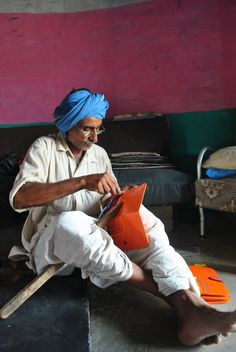 Leather artisan in Hodka village working on an order of wallets. They work for leading NGOs in Kutch and also sell their products directly especially during Rann Utsav.