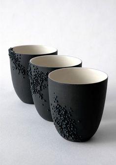 """Clémentine Dupré (France) - mugs en porcelaine décorée de mini-perles de porcelaine """"De l'infiniment petit au palpable, de l'aspérité, du grain de la peau à la porcelaine se définit une histoire, une porte nouvelle offerte à nos sens. De cette biologie fantasmée, la bactérie se fait décor pullulant, redéfinissant l'hygiène en esthétique. Au-delà des apparences, au-delà de la douceur, il existe une lecture plus précise… Je mets en lumière le micro-organisme."""""""