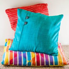 Update your home decor with this quick & easy tutorial for removable pillow covers. No sewing machine needed for this 15-minute project!