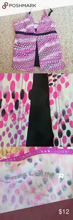 Free Country tankini top This beautiful swimsuit top has been worn a few times but is in excellent condition.  It is black white purple and bright pink. Free Country Swim Bikinis