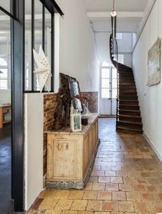 twisting narrow staircase and hall floor of pavers Staircase Landing, Narrow Staircase, Entry Stairs, Foyer Staircase, Entry Foyer, Narrow Hallways, House Entrance, Entrance Hall, Hall Flooring