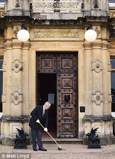 Highclere Castle: Wooden doors leading into the gothic front entrance hall designed by Sir Gilbert Scott, who also designed the Midland Hotel at St Pancras and the Albert Memorial