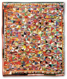 """Look closely to see that there is some sort of pattern in there.  Triangles meet to form diamonds.  Sooooo busy.  Scrappy quilt that while isn't a """"crazy"""" quilt, actually is very crazy."""