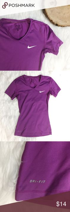 {NIKE} Purple Fitted Athletic Dri-Fit Top •Used, in great condition  •Purple •Super Stretchy and Comfortable  •Says S but fits like an XS •Fitted •V Neck •Breathable •Dri-Fit material  •Body: 84% Polyester 16% Spandex Back: 92% Polyester 8% Spandex Nike Tops Tees - Short Sleeve
