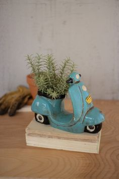Details Beep beep, coming through! This adorable ceramic moped planter is making a stop at your home. With a perfect size for small succulents or herbs, this piece will look great on a mantle or window x x Pottery Painting Designs, Paint Designs, Clay Art Projects, Clay Crafts, Ceramic Sculpture Figurative, Fimo Clay, Ceramic Planters, Clay Creations, Plant Decor