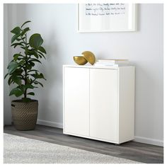 EKET Cabinet w 2 doors and 2 shelves White 70x25x70 cm - IKEA
