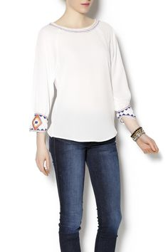 Peasant styled blouse, with 3/4 sleeve and tribal embroidered cuff. Beaded top stitched detail at neckline and cuff.   Itro Assorted Top by ITRO. Clothing - Tops - Long Sleeve Clothing - Sweaters - Crew & Scoop Neck Clothing - Tops - Blouses & Shirts Clothing - Tops - Casual Minnesota