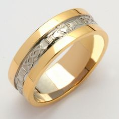 An exquisite Ladies Irish Wedding Ring in White Gold with Yellow Gold trim and intricately patterned in a Claddagh and Celtic design. Made in Ireland by Fado and hallmarked by the Assay Office in Dublin Castle. Ladies sizes 4-8.5 (including half sizes).