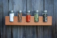 JONATHAN JANUARY, FIVE SHOOTER SPICE CADDY: i'd be tempted to keep only the best colored spices on view, rather than the ones i use the most.