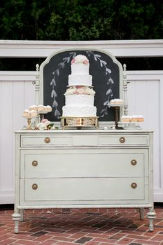 a vintage dresser used as a cake and dessert stand Photography: Ashley McCormick Photography - www.ashleymccormick.com  Read More: http://www.stylemepretty.com/southeast-weddings/2014/04/22/florida-wedding-full-of-vintage-charm/