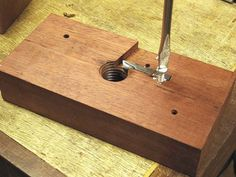 Wood Threading Fixture by Diego de Assis -- Homemade wood threading fixture consisting of a custom cutting blade, a hardwood block, and a large steel bolt. http://www.homemadetools.net/homemade-wood-threading-fixture