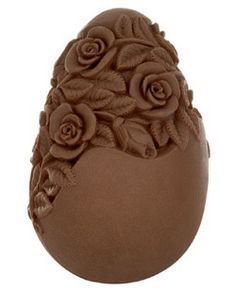 "This pretty carved egg is filled with twelve types of truffles and has been infused with a ""rose essence"". It looks pretty sweet......... <3 <3 <3"
