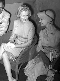 Marilyn Monroe with Vivien Leigh at a press conference for Marilyn's arrival in London, 1956.
