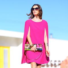 our #hotpink Gizela #capedress on #PalmSprings style superhero @kellygolightly accessorized w the 20th Anniversary print clutch & pump Thanks Kelly!  also available in black in our stores & @ trinaturk.com #TrinaTurk by trinaturk